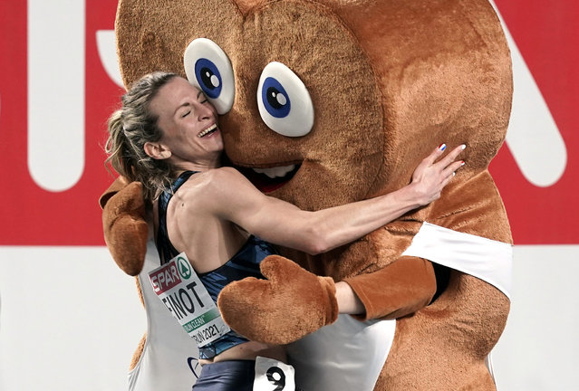 France's Alice Finot celebrates next to the mascot winning silver in the Women's 3000m final at the 2021 European Athletics Indoor Championships in Torun on March 5, 2021. (Photo by Aleksandra Szmigiel/Reuters)