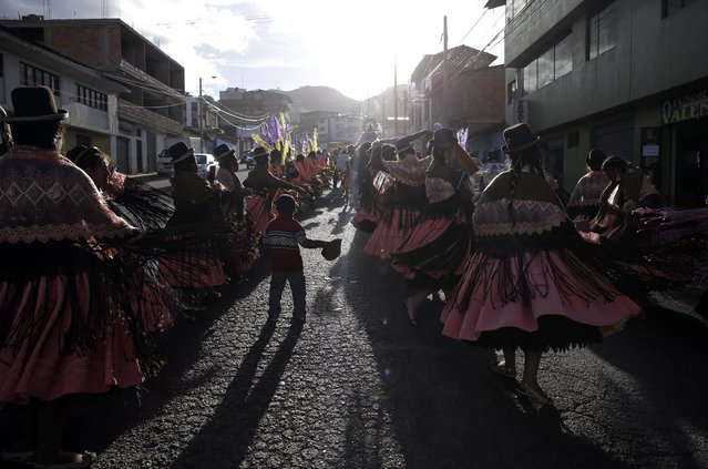 """In this Sunday, August 5, 2018 photo, dance troupes perform the """"Morenada"""" or Dance of the Black Slaves, during celebrations honoring Our Lady of Copacabana, in Cuzco, Peru. Although its origins are a subject of debate, the traditional Bolivian dance is comprised of a synergistic mix of African and Aymara influences. (Photo by Martin Mejia/AP Photo)"""