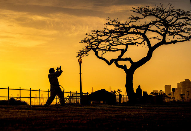 Tony Silva, of Long Beach, is silhouetted by the sunset while practicing his Karate moves amid nice weather at Bluff Park overlooking the ocean in Long Beach Tuesday, February 16, 2021. (Photo by Allen J. Schaben/Los Angeles Times/Rex Features/Shutterstock)