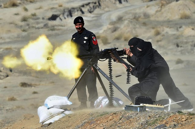 A Pakistani policewoman fires a heavy machine gun during a special elite police training course at a police training centre in Nowshera, a district in the Khyber Pakhtunkhwa Province on February 11, 2015. (Photo by A. Majeed/AFP Photo)