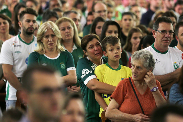 Fans of Chapecoense soccer team attend a mass at the Santo Antonio Cathedral in Chapeco, Brazil, November 29, 2016. (Photo by Paulo Whitaker/Reuters)
