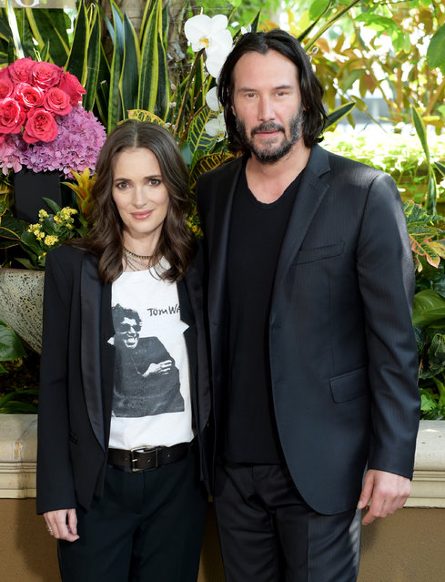 """Winona Ryder (L) and Keanu Reeves attend a photo call for Regatta's """"Destination Wedding"""" at the Four Seasons Hotel Los Angeles at Beverly Hills on August 18, 2018 in Los Angeles, California. (Photo by Kevin Winter/Getty Images)"""