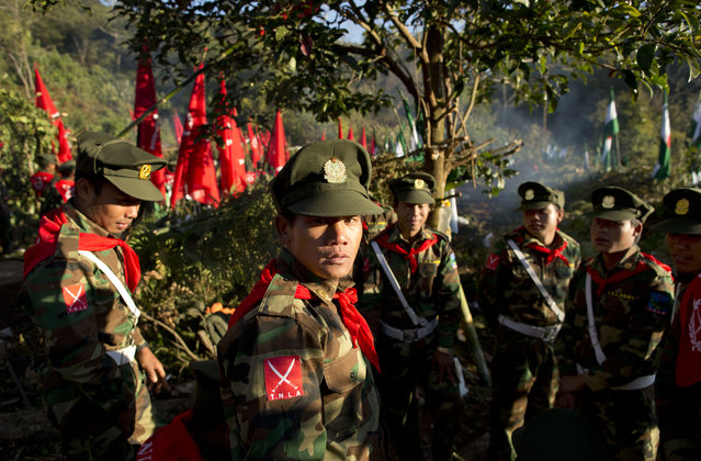 In this January 12, 2015 photo, officers with the Ta'ang National Liberation Army gather in the steep hillside jungles in Mar Wong, a village in northern Shan state, Myanmar. (Photo by Gemunu Amarasinghe/AP Photo)