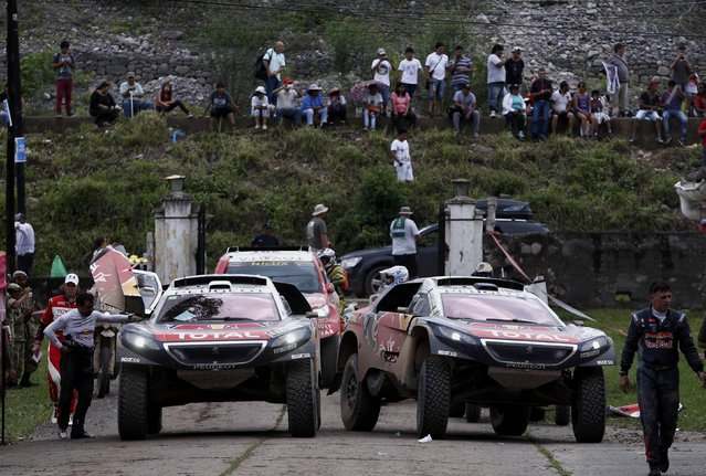 Carlos Sainz of Spain (R) drives his Peugeot past the Peugeot of Sebastien Loeb of France as they arrive at the bivouac at the end of the fourth stage in the Dakar Rally 2016 in Jujuy province, Argentina, January 6, 2016. (Photo by Marcos Brindicci/Reuters)