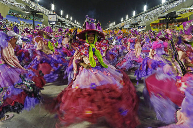 Dancers from the Mangueira samba school perform during the Carnival parade at the Sambadrome in Rio de Janeiro, Brazil, Monday, February 16, 2015. (Photo by Leo Correa/AP Photo)