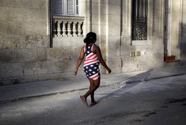 A woman wearing the colors of the U.S. flag walks on a street in Havana July 19, 2015. (Photo by Enrique de la Osa/Reuters)