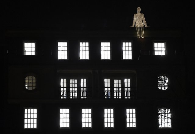 "An illuminated section of ""The Travellers"" by Cedric Le Borgne is seen on a building in St. James's Square as part of the ""Lumiere"" festival in London, Britain January 14, 2016. The event which takes place over four evenings in the capital sees the illumination of famous landmarks, and the display of artworks by international artists. (Photo by Toby Melville/Reuters)"
