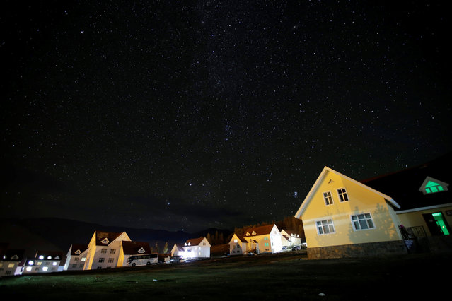 Stars are seen above buildings near the Kanas National Geological Park in Altay, China's Xinjiang Uygur Autonomous Region, September 24, 2016. (Photo by Jason Lee/Reuters)