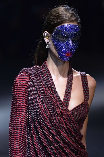 A model presents a creation for Givenchy during the 2014 Spring/Summer ready-to-wear collection fashion show in Paris, on October 1, 2013. (Photo by Miguel Medina/AFP Photo)