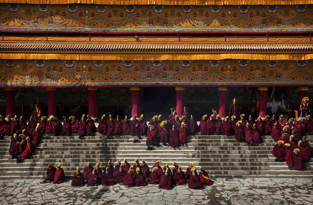 Tibetan Buddhist monks gather during Monlam or the Great Prayer rituals on March 5, 2015 at the Labrang Monastery, Xiahe County, Amdo, Tibetan Autonomous Prefecture, Gansu Province, China. (Photo by Kevin Frayer/Getty Images)