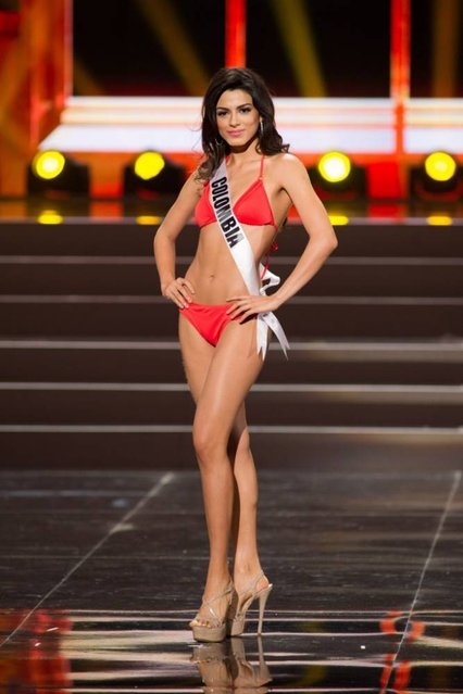 This photo provided by the Miss Universe Organization shows Lucia Aldana, Miss Colombia 2013, competes in the swimsuit competition during the Preliminary Competition at Crocus City Hall, Moscow, on November 5, 2013. (Photo by Darren Decker/AFP Photo)