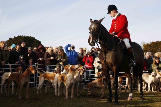 Members of the New Forest Hunt and the public arrive at Boltons Bench for the annual Boxing Day hunt in Lyndhurst, southern England December 26, 2016. (Photo by Luke MacGregor/Reuters)