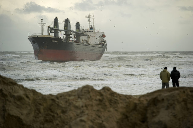 People look at the Aztec Maiden, a Philippine-registered freighter, off a Dutch beach in Wijk aan Zee January 20, 2012. The Philippine cargo ship ran aground off the Dutch coast on Friday after breaking its anchor, Dutch media reported. (Photo by Robin van Lonkhuijsen/Reuters/United Photos)