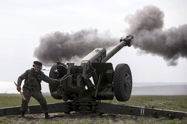 Ukraine's voluntary militia called the Azov Battalion holds artillery training in east Ukraine's village of Urzuf that sits west of the port city of Mariupol on the Azov Sea, March 19, 2015. (Photo by Marko Djurica/Reuters)