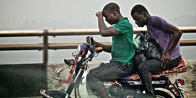 """Riders in the Storm"". Africa's Longest Bridge. Photo location: Third Mainland Bridge, Lagos Nigeria. (Photo and caption by Adam Biddle/National Geographic Photo Contest)"