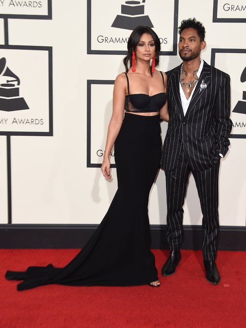 Singer  Miguel (R) and his wife Nazanin Mandi arrive on the red carpet for the 58th Annual Grammy music Awards in Los Angeles February 15, 2016. (Photo by Valerie Macon/AFP Photo)