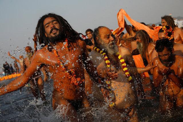 "Naga Sadhus or Hindu holy men take a dip during the first ""Shahi Snan"" (grand bath) during ""Kumbh Mela"" or the Pitcher Festival, in Prayagraj, previously known as Allahabad, India, January 15, 2019. (Photo by Danish Siddiqui/Reuters)"