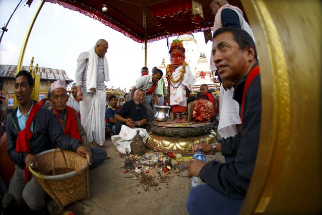 An idol of Rato Machhindranath is placed at the centre of a courtyard while the priests perform religious ritual at Bungamati in Lalitpur April 5, 2015. (Photo by Navesh Chitrakar/Reuters)