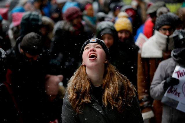 Molly Durkin tries to catch a snowflake on her tongue during the Young Women's March at Federal Plaza on January 19, 2019 in Chicago, Illinois. Thousands of women gathered across the United States for their annual message opposing Donald Trump and supporting women's rights. (Photo by Joshua Lott/AFP Photo)