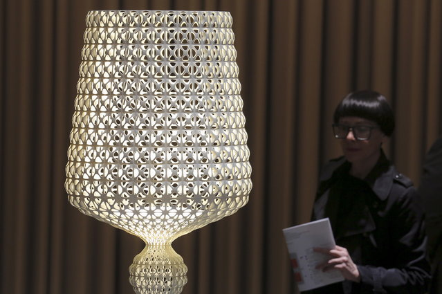 """A visitor looks at a creation by Kartell named """"Kabuki"""" during the Milan Design Week, April 14, 2015. (Photo by Stefano Rellandini/Reuters)"""