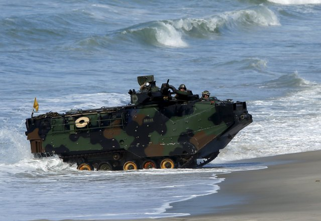 Soldiers from Japan's Ground Self Defense Force come ashore in amphibious assault vehicle as they train alongside U.S. Marines during the bilateral annual Iron Fist military training exercise in Camp Pendleton, California February 26, 2016. (Photo by Mike Blake/Reuters)