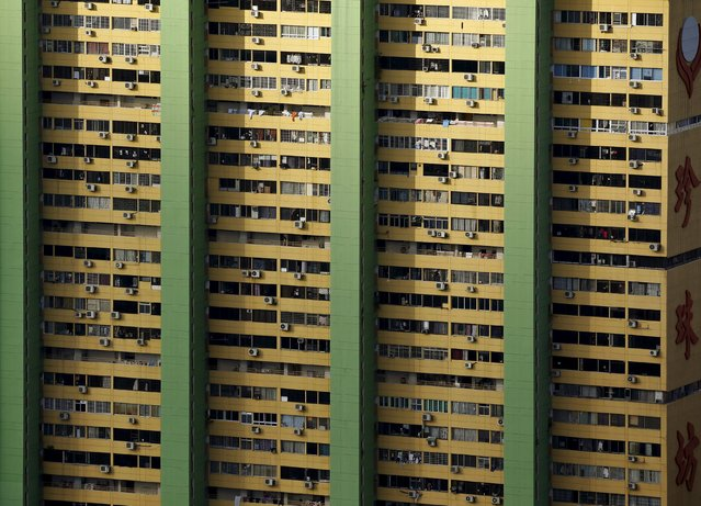 Air-conditioning units dot the facade of the People's Park Complex residential apartment in Singapore's Chinatown February 29, 2016. The 31-storey apartment block, one of the first high-rise residential projects in the city-state, was completed in 1973. (Photo by Edgar Su/Reuters)