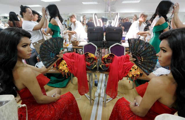 Adriana Jay from Peru prepares backstage during the final show of the Miss International Queen 2019 transgender beauty pageant in Pattaya, Thailand on March 8, 2019. (Photo by Jorge Silva/Reuters)
