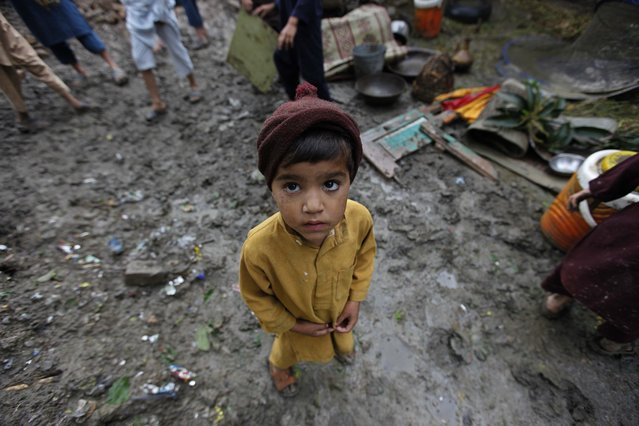 A child looks on at an area affected by torrential rains in Peshawar, Pakistan, 27 April 2015. (Photo by Bilawal Arbab/EPA)