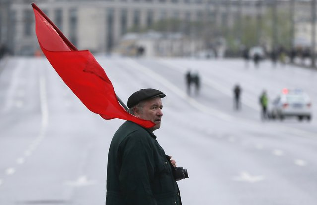 A supporter of Russia's Communist party holds a flag during a May Day rally in Moscow May 1, 2015. (Photo by Maxim Shemetov/Reuters)