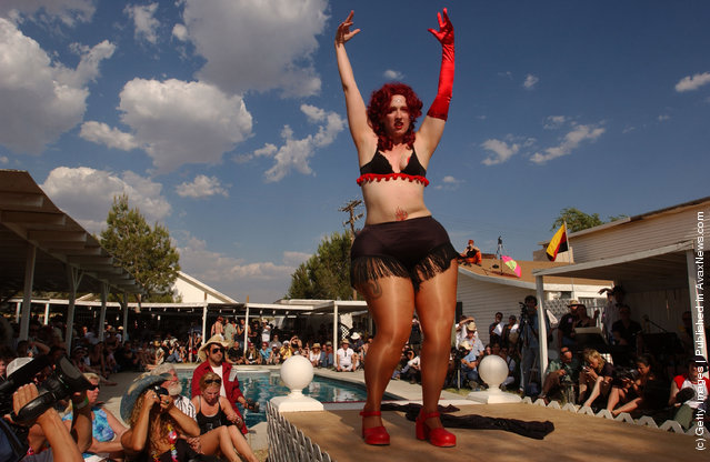 Ms. DeMeanor, of San Fransisco, competes in the Miss Exotic World Pageant at the Exotic World Burlesque Museum on June 7, 2003 in Helendale outside of Barstow, California