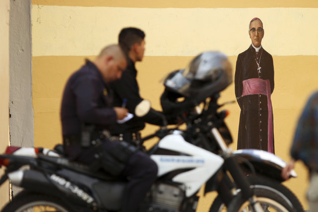 Salvadoran police officers patrol near the Metropolitan Cathedral before the arrival of California Gov. Gavin Newsom in San Salvador, El Salvador, Sunday, April 7, 2019. Newsom visited the tomb of Archbishop Romero, the Salvadoran priest assassinated in 1980 due to his advocacy for human rights and the poor. (Photo by Salvador Melendez/AP Photo)