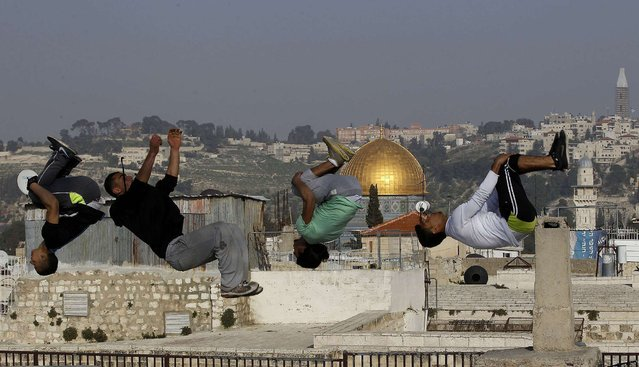 Palestinian youths practice their parkour skills in Jerusalem's Old City February 24, 2014. (Photo by Ammar Awad/Reuters)