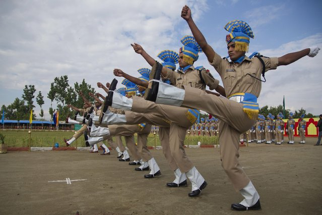 Newly recruited members of the Indian Central Reserve Police Force (CRPF) salute during their commencement parade at a base camp on the outskirts of Srinagar, Indian controlled Kashmir, Thursday, May 14, 2015. More than three hundred new CRPF soldiers will join the Indian security men fighting separatist Islamic guerrillas in Kashmir and Maoist rebels in different parts of India. (Photo by Dar Yasin/AP Photo)