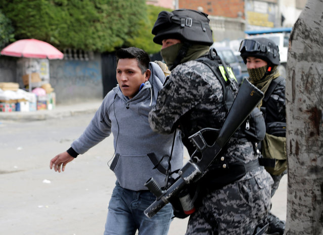 A coca grower from Yungas is arrested by riot policemen during clashes in La Paz, Bolivia February 21, 2017. (Photo by David Mercado/Reuters)