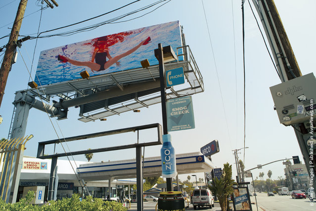 Photographer/artist Jill Greenberg's billboard seen on Sunset Blvd. to promote her Exhibit Glass Ceiling: American Girl Doll