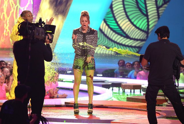 Kaley Cuoco gets slimed at the 27th annual Kids' Choice Awards at the Galen Center on Saturday, March 29, 2014, in Los Angeles. (Photo by Matt Sayles/Invision/AP Photo)