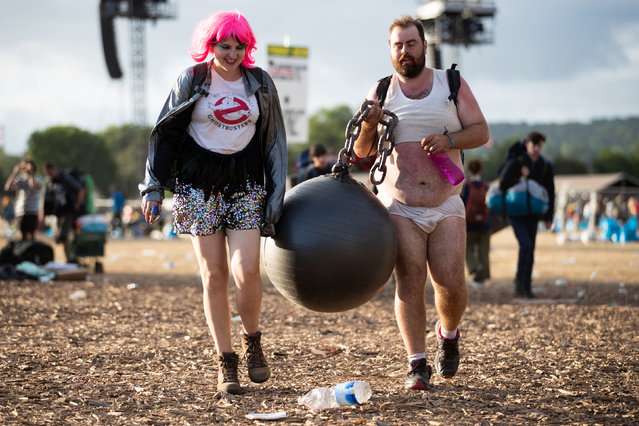 Festival goers return to their tents and leave the camp as clean up begins at the Glastonbury Festival at Worthy Farm in Somerset. England on July 1, 2019. (Photo by Aaron Chown/PA Images via Getty Images)