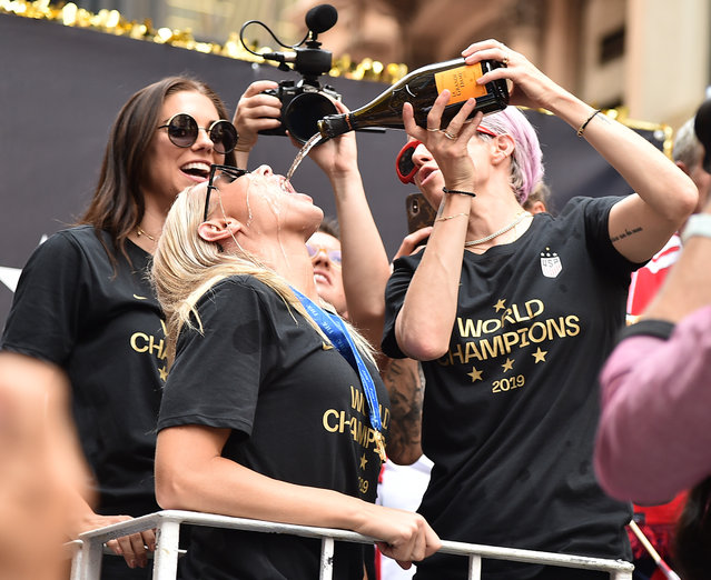 Alex Morgan, Ali Krieger and Megan Rapinoe celebrate during a Victory Ticker Tape Parade for the U.S. Women's National Soccer Team down the Canyon of Heroes on July 10, 2019 in the Manhattan borough of New York City. The USA defeated the Netherlands on Sunday to win the 2019 FIFA Women's World Cup France. (Photo by Theo Wargo/Getty Images)