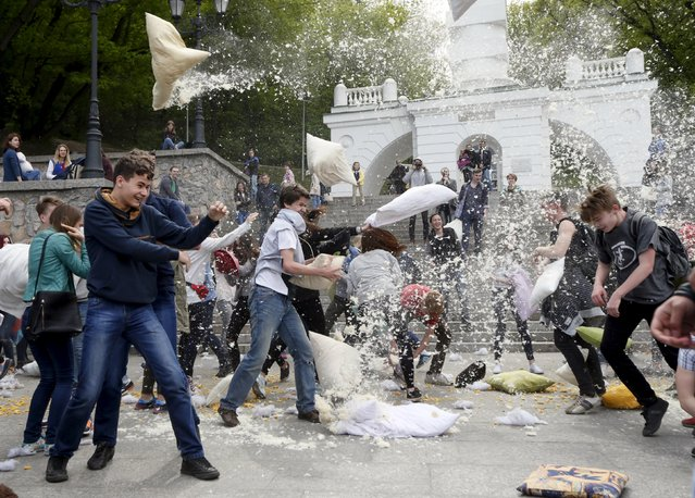 People take part in a pillow fight during a flash mob in Kiev, Ukraine, April 24, 2016. (Photo by Valentyn Ogirenko/Reuters)