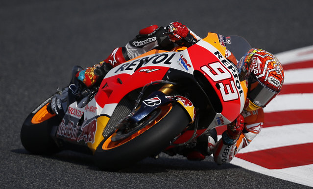 Honda's rider Marc Marquez steers his bike during the third free practice for the motorcycle GP in Montmelo, Spain, Saturday, June 13, 2015. The Catalunya Grand Prix will take place on Sunday in Montmelo. (AP Photo/Manu Fernandez)