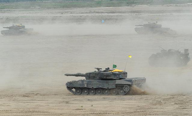 Polish Army tanks take part in the NATO Noble Jump exercise on a training range near Swietoszow Zagan, Poland, Thursday, June 18, 2015. (AP Photo/Alik Keplicz)