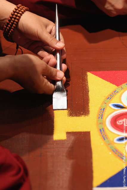 Tibetan Monks From The Panchen Lama's Monastery Create A Sand Mandala Artwork