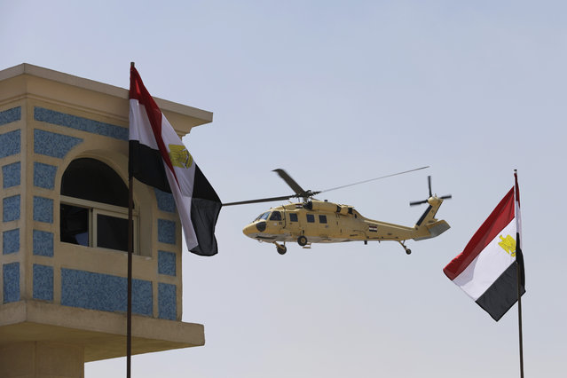 A helicopter carries Egyptian President Abdel-Fattah el-Sissi after the funeral of Prosecutor General Hisham Barakat, killed in a bomb attack a day earlier, outside the Field Marshal Mohammed Hussein Tantawi Mosque in Cairo, Egypt, Tuesday, June 30, 2015. Heavy security forces deployed across the Egyptian capital for the burial of Barakat, the top judicial official in charge of overseeing prosecution of thousands of Islamists. (Photo by Hassan Ammar/AP Photo)