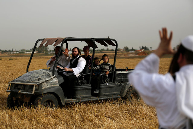 A group of Ultra-Orthodox Jewish people rides an ATV in the Ultra-Orthodox moshav of Komemiyut  May 3, 2016. (Photo by Amir Cohen/Reuters)