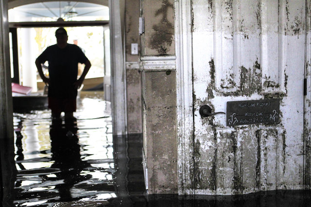 Don Duplantier walks through his flooded home as water recedes from Hurricane Isaac in Braithwaite, La., Sunday, September 2, 2012. (Photo by Gerald Herbert/AP Photo)