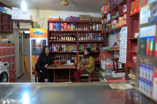 Women chat inside a store in Guangfuli neighbourhood in Shanghai, China, April 1, 2016. (Photo by Aly Song/Reuters)