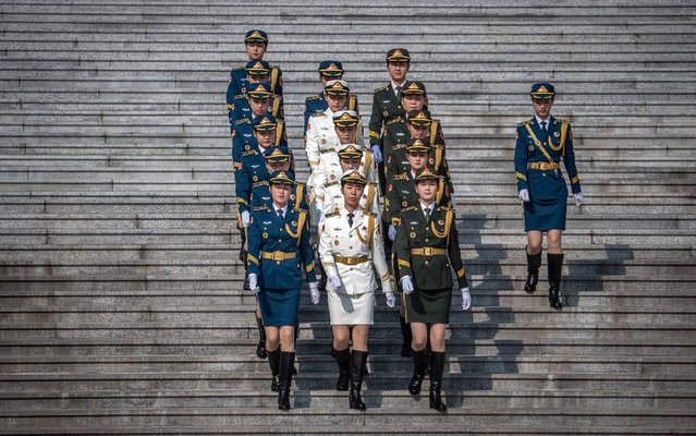 Female members of an honor guard march prior to a welcome ceremony for German Chancellor Angela Merkel at the Great Hall of the People in Beijing, China, 06 September 2019. Merkel is on a visit to China from 06 to 07 September 2019. (Photo by Roman Pilipey/EPA/EFE/Rex Features/Shutterstock)