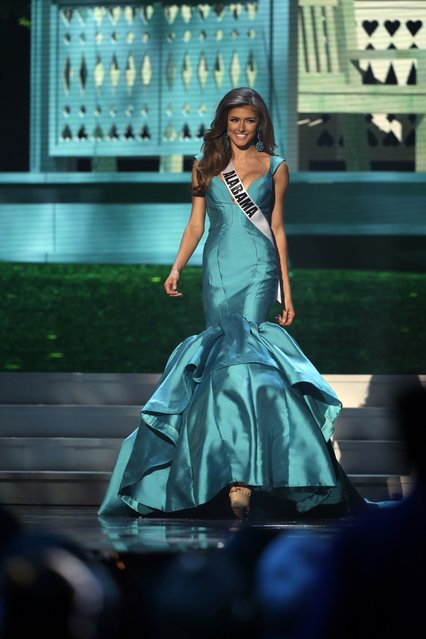 Miss Alabama, Madison Guthrie, competes in the evening gown competition during the preliminary round of the 2015 Miss USA Pageant in Baton Rouge, La., Wednesday, July 8, 2015. (Photo by Gerald Herbert/AP Photo)