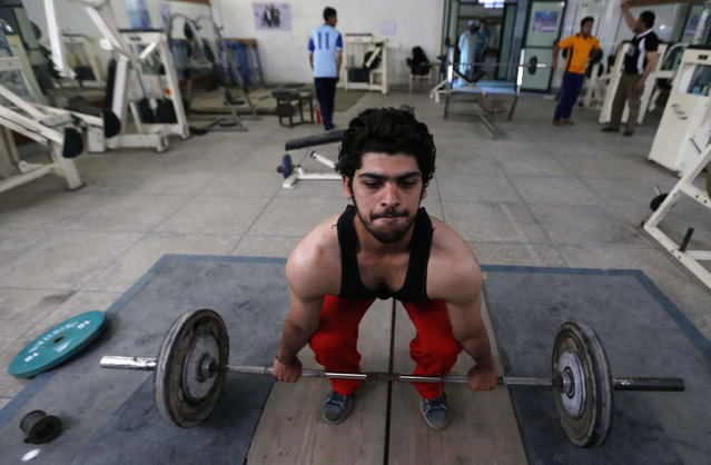 A Pakistani man lifts weights on World Health Day, in Peshawar, Pakistan, April 7, 2013. World Health Day is celebrated on April 7 each year to mark the World Health Organisation's (WHO) founding in 1948 and to draw worldwide attention to the importance of good health. (Photo by Bilawal Arbab/EPA)