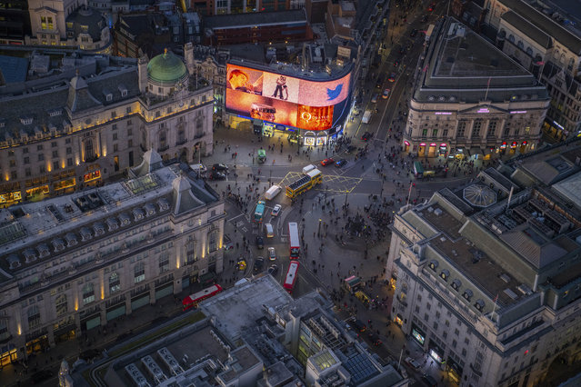 Night aerial view of Piccadilly Circus, London. (Photo by Jason Hawkes/Caters News Agency)